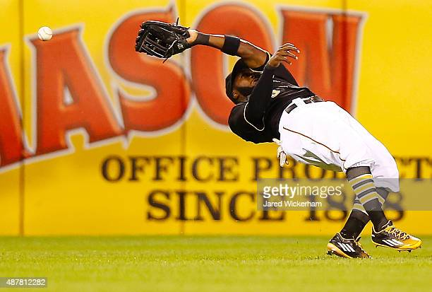 Josh Harrison of the Pittsburgh Pirates misplays a fly ball in left field in the fourth inning against the Milwaukee Brewers during the game at PNC...