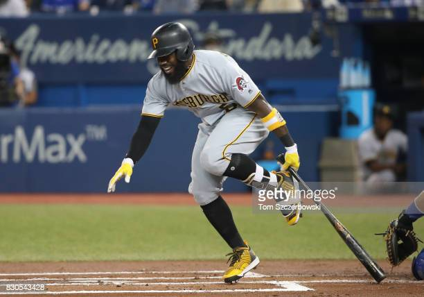 Josh Harrison of the Pittsburgh Pirates reacts after fouling a ball off his foot in the first inning during MLB game action against the Toronto Blue...