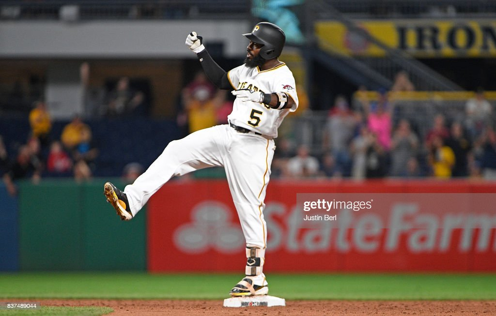Josh Harrison #5 of the Pittsburgh Pirates reacts after hitting a two run double to right field in the third inning during the game against the Los Angeles Dodgers at PNC Park on August 22, 2017 in Pittsburgh, Pennsylvania.