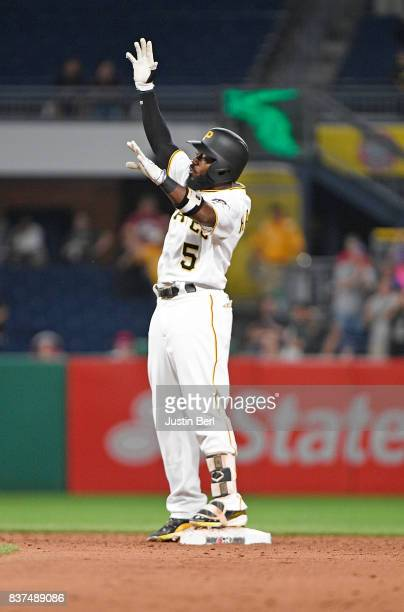 Josh Harrison of the Pittsburgh Pirates reacts after hitting a two run double to right field in the third inning during the game against the Los...