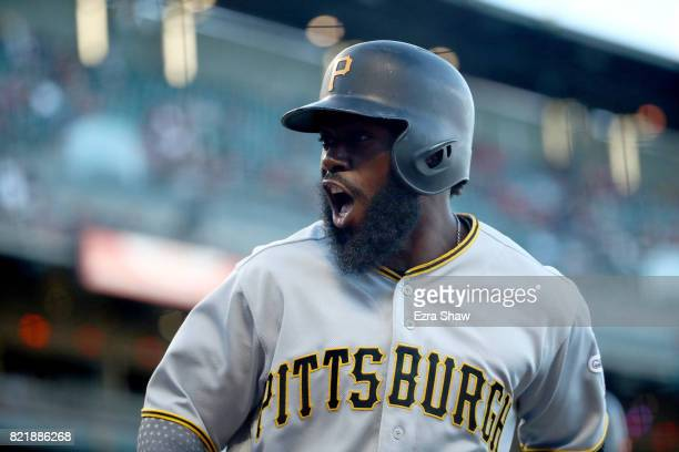 Josh Harrison of the Pittsburgh Pirates reacts after scoring in the first inning against the San Francisco Giants at ATT Park on July 24 2017 in San...