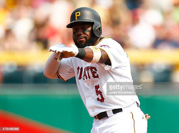 Josh Harrison of the Pittsburgh Pirates reacts following a double against the Cleveland Indians during the interleague game at PNC Park on July 4...