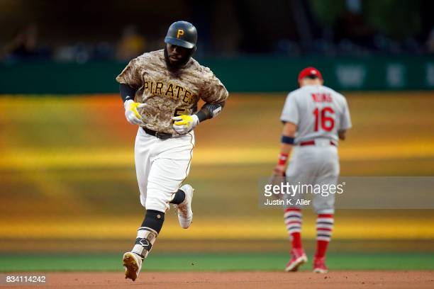 Josh Harrison of the Pittsburgh Pirates rounds second after hitting a two run home run in the first inning against the St Louis Cardinals at PNC Park...