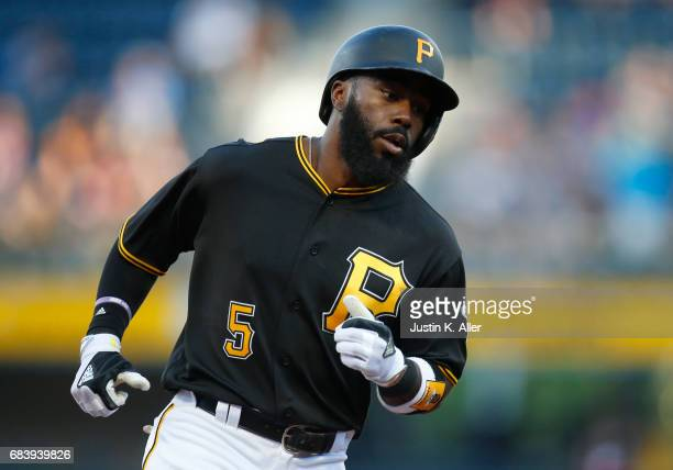 Josh Harrison of the Pittsburgh Pirates rounds third after hitting a solo home run in the first inning against the Washington Nationals at PNC Park...