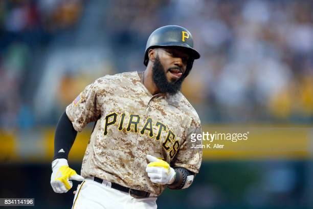Josh Harrison of the Pittsburgh Pirates rounds third after hitting a two run home run in the first inning against the St Louis Cardinals at PNC Park...