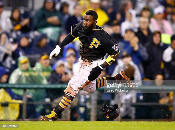 Josh Harrison of the Pittsburgh Pirates rounds third base before scoring in the fourth inning against the Milwaukee Brewers during the game at PNC...