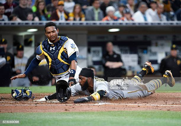 Josh Harrison of the Pittsburgh Pirates scores on a wild pitch past the the tag of Christian Bethancourt of the San Diego Padres during the fourth...