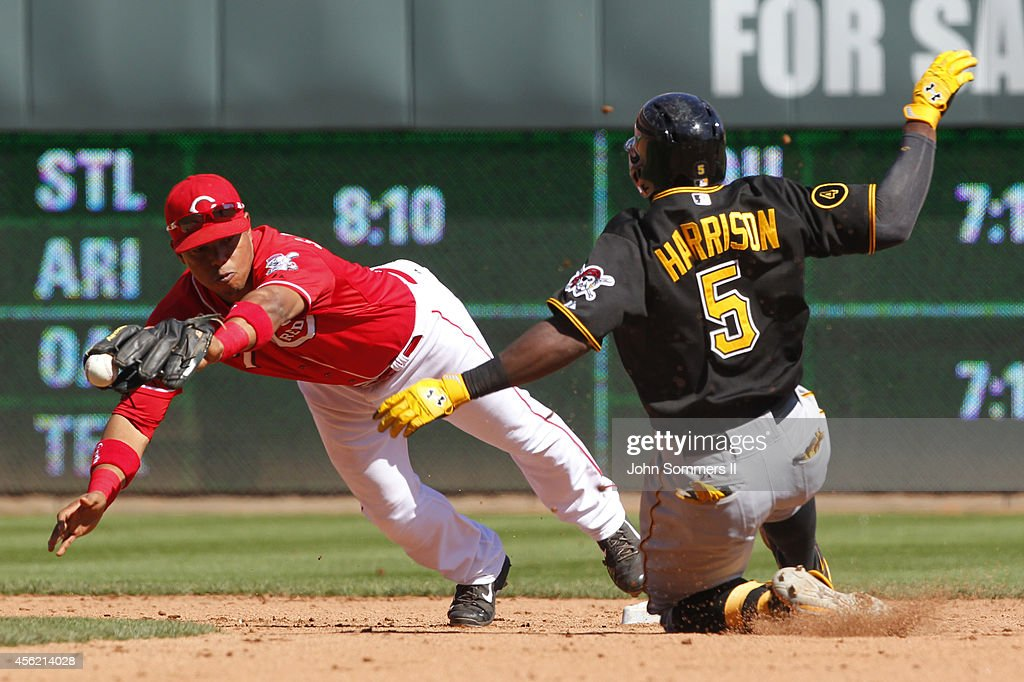 Josh Harrison #5 of the Pittsburgh Pirates slides in safe ahead of the tag at second base by Ramon Santiago #7 Cincinnati Reds at Great American Ball Park on September 27, 2014 in Cincinnati, Ohio.