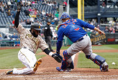Josh Harrison of the Pittsburgh Pirates slides into home plate past Wellington Castillo of the Chicago Cubs after scoring the goahead run in the...