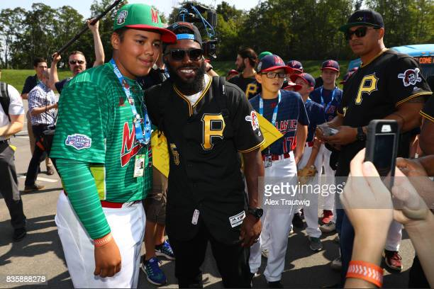 Josh Harrison of the Pittsburgh Pirates take a photo with Erick Vazquez of the Mexican team from Reynosa during the 2017 Little League World Series...