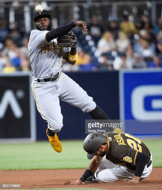 Josh Harrison of the Pittsburgh Pirates throws over Carlos Asuaje of the San Diego Padres as he turns a double play during the seventh inning of a...