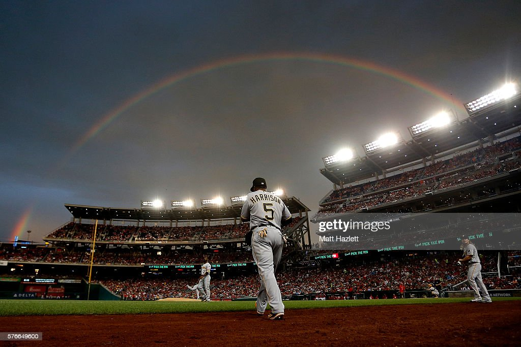 Josh Harrison of the Pittsburgh Pirates walks onto the field under a rainbow in the first inning against the Washington Nationals at Nationals Park...