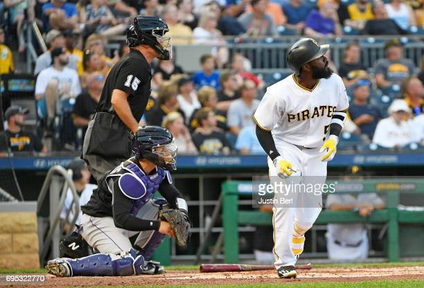 Josh Harrison of the Pittsburgh Pirates watches his two run home run go over the wall in the first inning during the game against the Colorado...