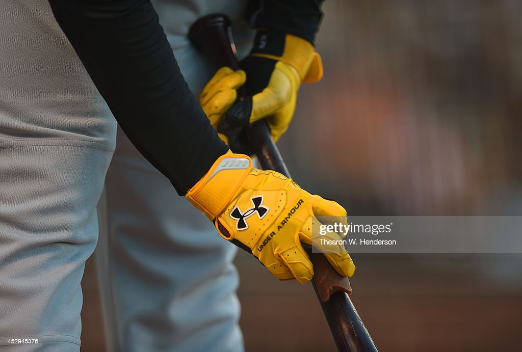 Josh Harrison #5 of the Pittsburgh Pirates wearing Under Armour batting gloves, works on the handle of his bat in the on-deck circle against the San Francisco Giants in the top of the second inning at AT&T Park on July 29, 2014 in San Francisco, California.