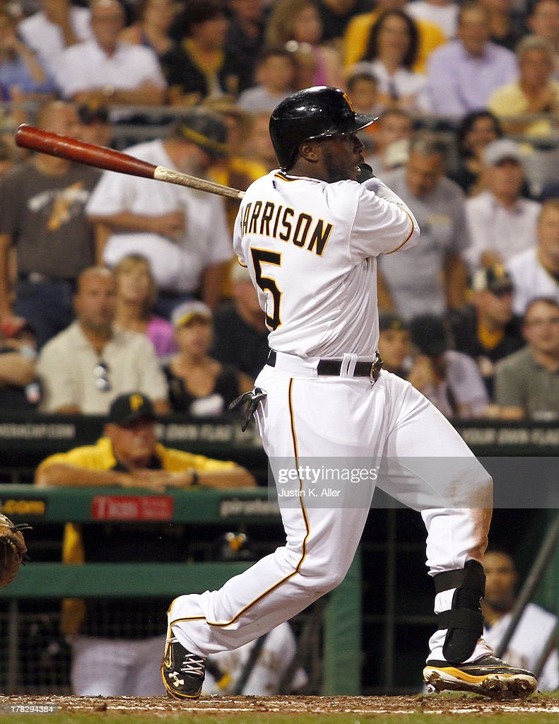 Josh Harrison #5 of the Pittsburgh Piratesp hits an RBI single in the fifth inning against the Milwaukee Brewers during the game on August 28, 2013 at PNC Park in Pittsburgh, Pennsylvania.