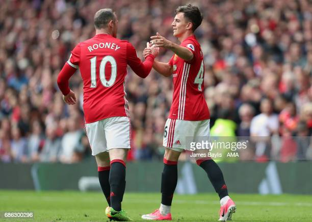 Josh Harrop of Manchester United celebrates with Wayne Rooney of Manchester United after scoring a goal to make it 10 during the Premier League match...