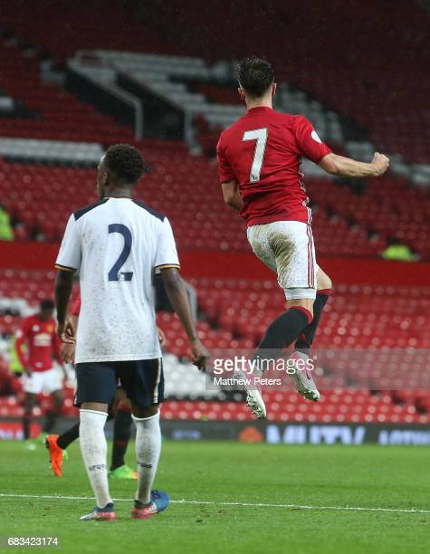 Josh Harrop of Manchester United U23s celebrates scoring their second goal during the Premier League 2 match between Manchester United U23s and...