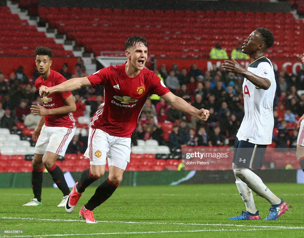 Josh Harrop of Manchester United U23s celebrates scoring their third goal during the Premier League 2 match between Manchester United U23s and Tottenham Hotspur U23s at Old Trafford on May 15, 2017 in Manchester, England.
