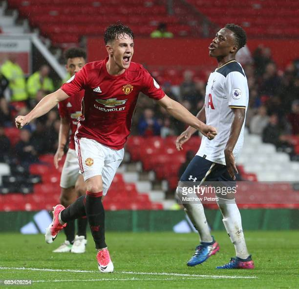 Josh Harrop of Manchester United U23s celebrates scoring their third goal during the Premier League 2 match between Manchester United U23s and...