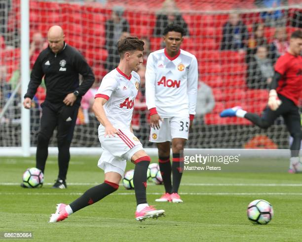 Josh Harrop of Manchester United warms up ahead of the Premier League match between Manchester United and Crystal Palace at Old Trafford on May 21...