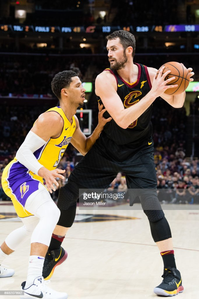 Josh Hart #5 of the Los Angeles Lakers guards Kevin Love #0 of the Cleveland Cavaliers during the second half at Quicken Loans Arena on December 14, 2017 in Cleveland, Ohio. The Cavaliers defeated the Lakers 121-112.