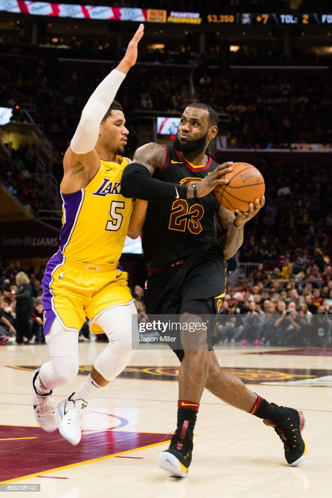 Josh Hart #5 of the Los Angeles Lakers tries to stop LeBron James #23 of the Cleveland Cavaliers during the second half at Quicken Loans Arena on December 14, 2017 in Cleveland, Ohio. The Cavaliers defeated the Lakers 121-112.