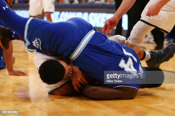 Josh Hart of the Villanova Wildcats and Ismael Sanogo of the Seton Hall Pirates battle for control of the loose ball during the Big East Basketball...