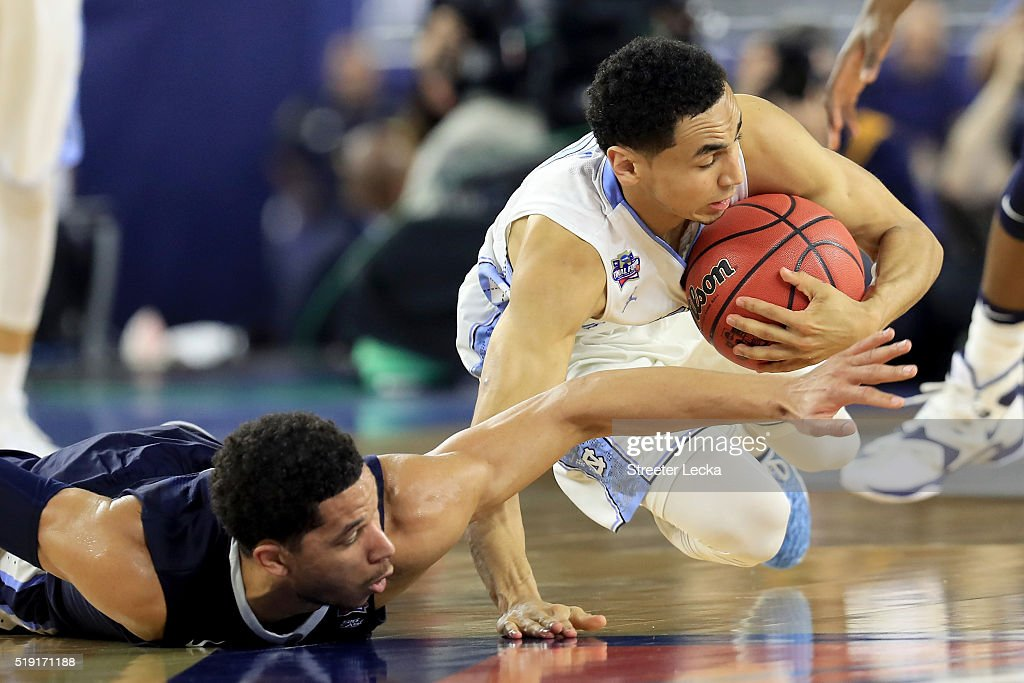 Josh Hart of the Villanova Wildcats and Marcus Paige of the North Carolina Tar Heels battle for the loose ball in the second half of the 2016 NCAA...