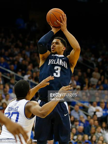 Josh Hart of the Villanova Wildcats attempts a shot as Angel Delgado of the Seton Hall Pirates defends during the first half of an NCAA college...