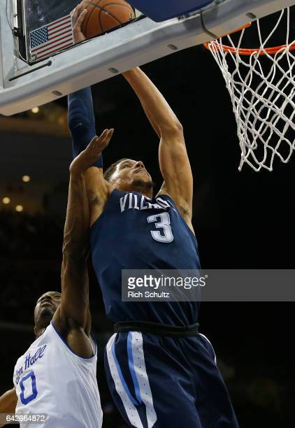 Josh Hart of the Villanova Wildcats attempts a shot as Khadeen Carrington of the Seton Hall Pirates defends during the second half of an NCAA college...