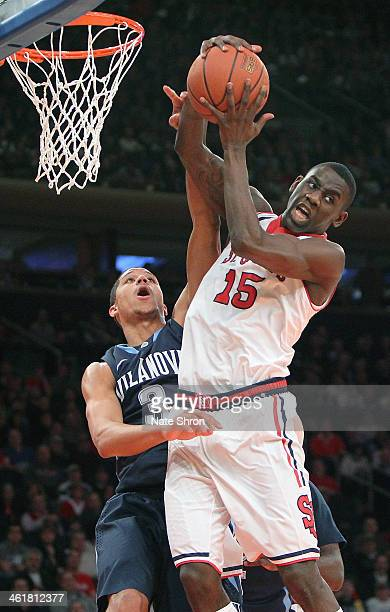 Josh Hart of the Villanova Wildcats attempts to block the shot of JaKarr Sampson of the St John's Red Storm during the game at Madison Square Garden...