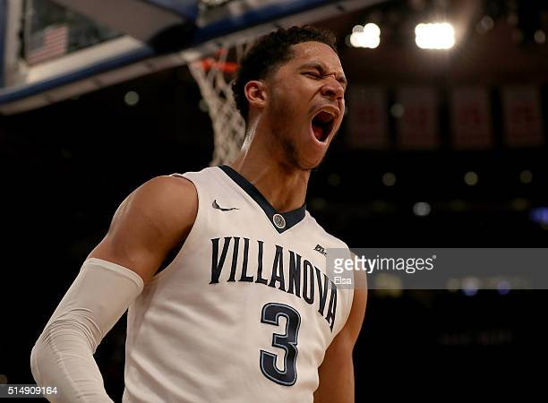 Josh Hart of the Villanova Wildcats celebrates his dunk in the final minutes of the game against the Providence Friars during the semifinals of the...