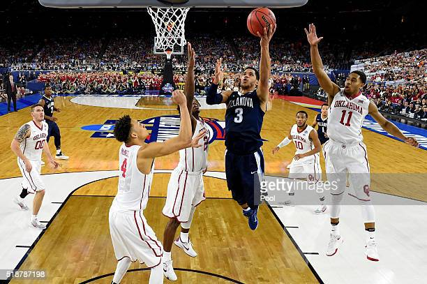 Josh Hart of the Villanova Wildcats drives to the basket against Jamuni McNeace of the Oklahoma Sooners Buddy Hield and Isaiah Cousins in the second...