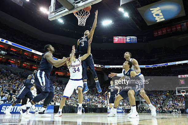 Josh Hart of the Villanova Wildcats shoots the ball in the first half against Perry Ellis of the Kansas Jayhawks during the 2016 NCAA Men's...