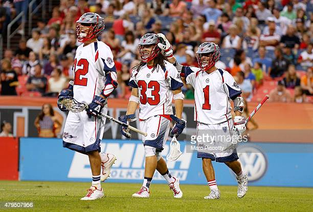 Josh Hawkins of the Boston Cannons celebrates with teammates Wells Stanwick and Will Manny after a goal against the Denver Outlaws during their MLL...