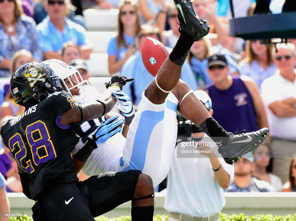 Josh Hawkins #28 of the East Carolina Pirates is called for pass interference as he breaks up a pass intended for Bug Howard #84 of the North Carolina Tar Heels during play at Kenan Stadium on September 28, 2013 in Chapel Hill, North Carolina. East Carolina won 55-31.