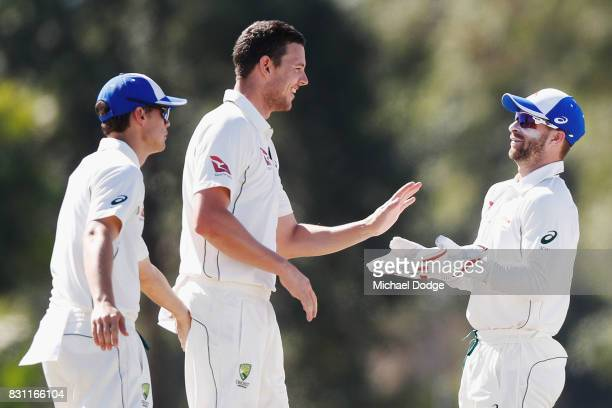 Josh Hazelwood celebrates the wicket of David Warner with Matthew Wade during day one of the Australian Test cricket intersquad match at Marrara...