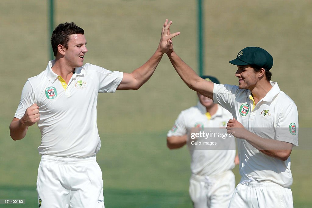 Josh Hazelwood of Australia A celebrates the wicket of Reeza Hendricks of South Africa A with his team mates during day 2 of the 1st Test match between South Africa A and Australia A at Tuks Oval on July 25, 2013 in Pretoria, South Africa.