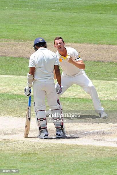 Josh Hazelwood of Australia celebrates the wicket of Murali Vijay of India during day five of the Third Test match between Australia and India at...