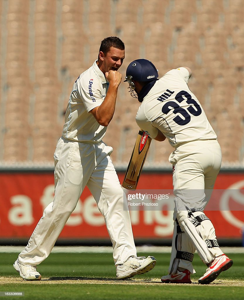 Josh Hazelwood of the Blues celebrates the wicket of Michael Hill of the Bushrangers during day two of the Sheffield Shield match between the Victorian Bushrangers and the New South Wales Blues at Melbourne Cricket Ground on March 8, 2013 in Melbourne, Australia.
