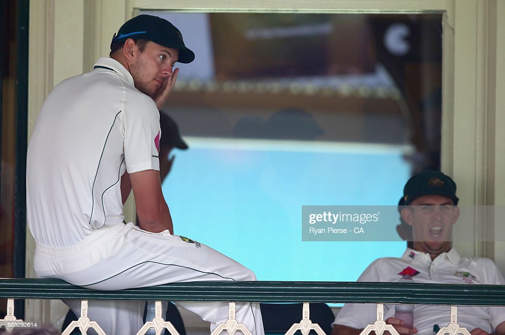 Josh Hazlewood and Mitch Marsh of Australia look on as rain delays play during day two of the third Test match between Australia and the West Indies...
