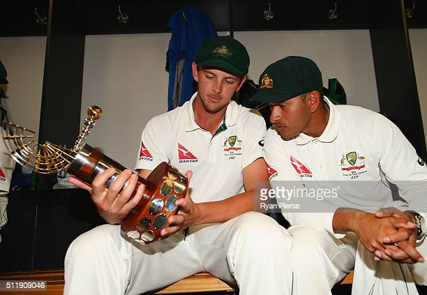 Josh Hazlewood and Usman Khawaja of Australia celebrate with the TransTasman Trophy in the change rooms after day five of the Test match between New...
