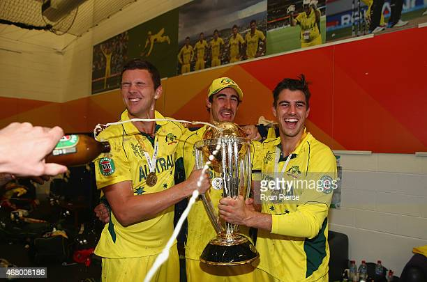 Josh Hazlewood Mitchell Starc and Pat Cummins of Australia pose with the trophy in the chnage rooms during the 2015 ICC Cricket World Cup final match...