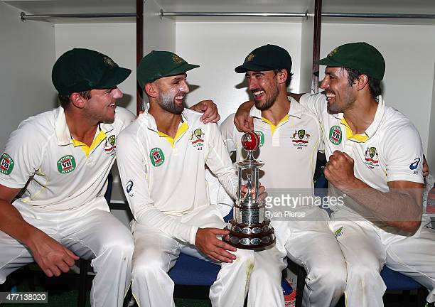 Josh Hazlewood Nathan Lyon Mitchell Starc and Mitchell Johnson of Australia pose with the Frank Worrell Trophy during day four of the Second Test...