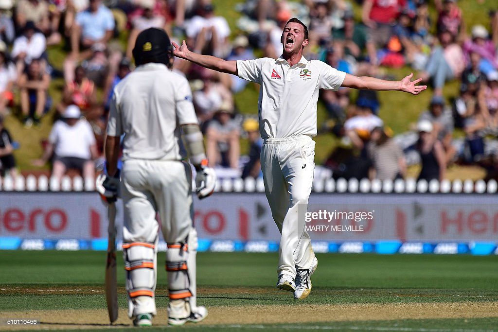 Josh Hazlewood (R) of Australia appeals for a LBW call on Henry Nicholls of New Zealand with New Zealand's Tom Latham (L) during day three of the first cricket Test match between New Zealand and Australia at the Basin Reserve in Wellington on February 14, 2016. AFP PHOTO / MARTY MELVILLE / AFP / Marty Melville