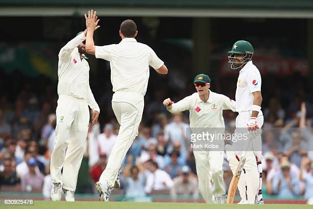 Josh Hazlewood of Australia celebrate the wicket of Babar Azam of Pakistan as he looks dejected as he watches on during day two of the Third Test...