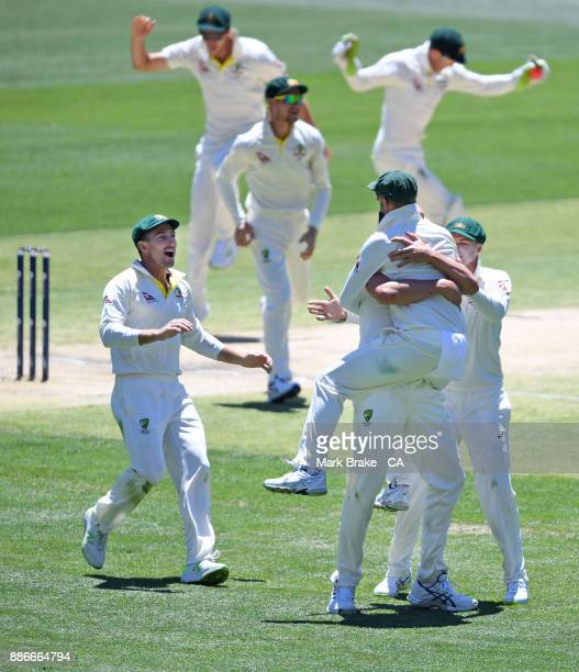 Josh Hazlewood of Australia celebrates after taking the wicket of Joe Root of England during day five of the Second Test match during the 2017/18...