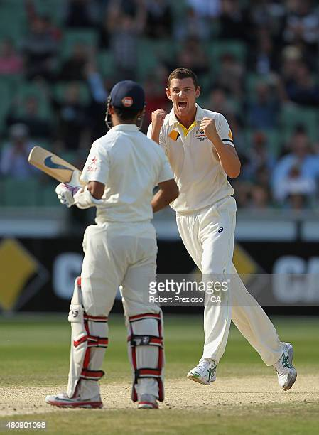 Josh Hazlewood of Australia celebrates after taking the wicket of Ajinkya Rahane of India during day five of the Third Test match between Australia...