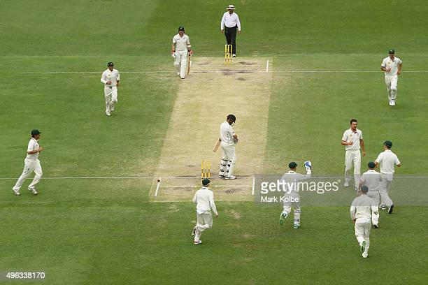Josh Hazlewood of Australia celebrates after taking the wicket of Ross Taylor of New Zealand during day five of the First Test match between...