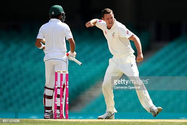 Josh Hazlewood of Australia celebrates dismissing Babar Azam of Pakistan during day five of the Third Test match between Australia and Pakistan at...
